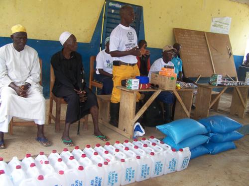 Robert Jawara explaining Narsarah Ebola Response strategy.