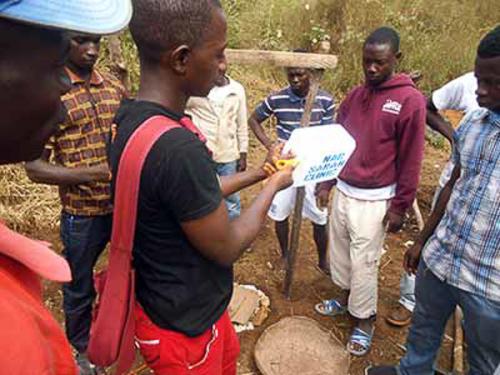 Balla Jawara-Nar sarah staff training youths to make tippy-tap